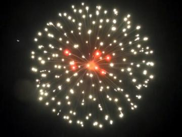 5 inch shell white strobe w/red crossette. Professional RedWire fireworks, distributed by Xena Vuurwerk from Holland