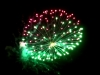 """Red Wire professional fireworks 4 inch shell : Half green- half purple. Available in assorted 4"""" shells at Xena Vuurwerk"""