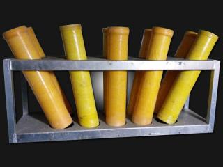 Fanshaped mortar rack with 4 inch mortar tubes for rent. 10 tubes per rack. Available for rent at Xena Vuurwerk, professional fireworks supplier