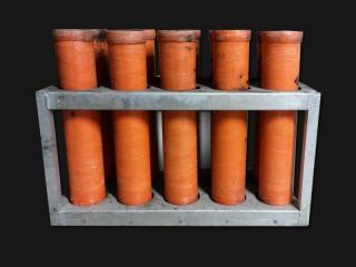 Mortar rack with 4 inch mortar tubes for rent. 10 tubes per rack. Available for rent at Xena Vuurwerk, professional fireworks supplier